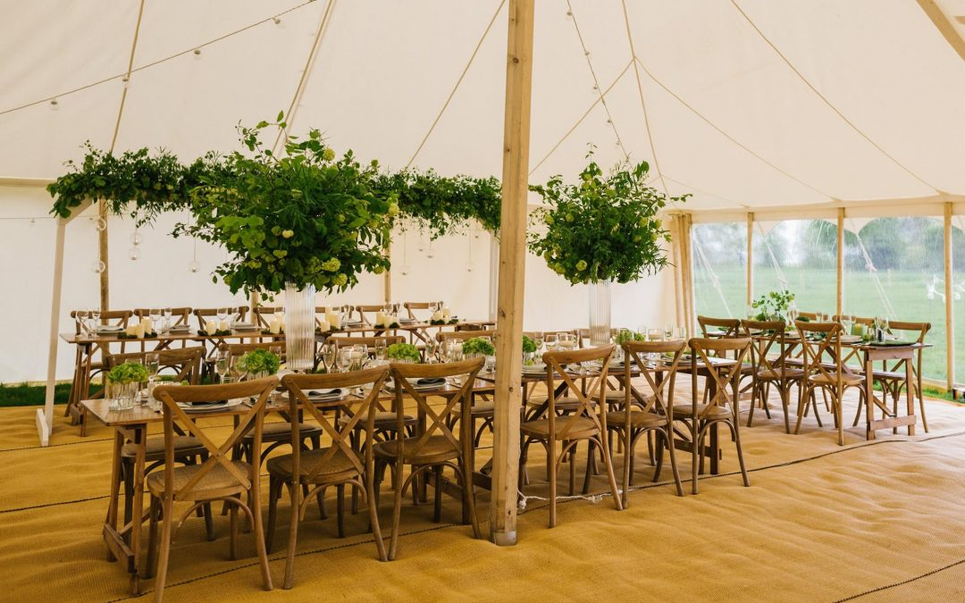 Our tables and chairs providing the perfect touch to this beautiful set up!